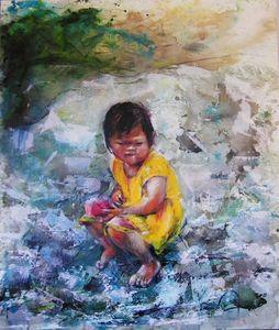 Enfant sur le tas de cailloux