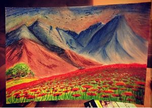 Red poppy field in the mountains