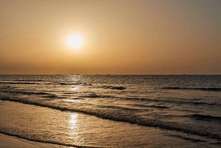 Beautiful golden sunset on the beach - Chandra