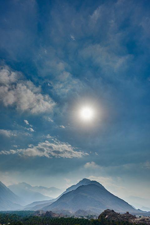 Sun shining on a landscape of trees - Chandra