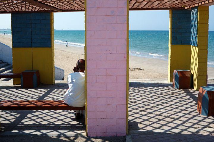 Man in the shade watching - Chandra