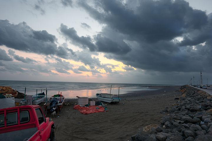 Fishing boats on a beach at sunrise - Chandra