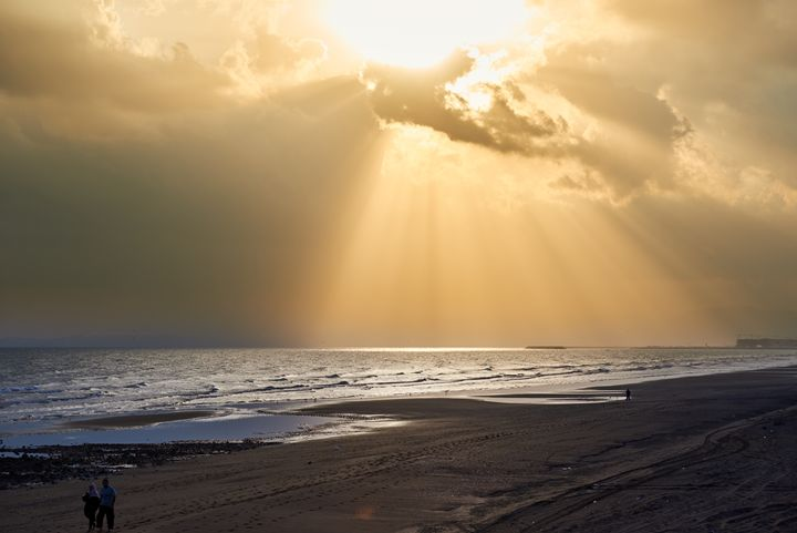 Sunbeams bursting through clouds - Chandra
