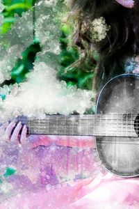 The girl playing the guitar