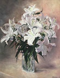 Lilies in cut glass vase.