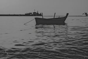 A Boat In The Sea - Hua Huang