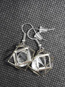 Metal earrings with diamond
