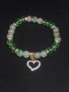 Light green bracelet with gold heart