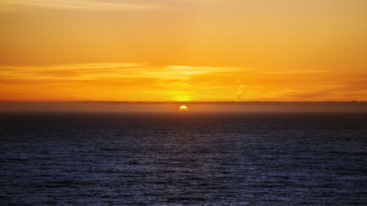Beautiful glowing misty sunset - Jesse Redheart