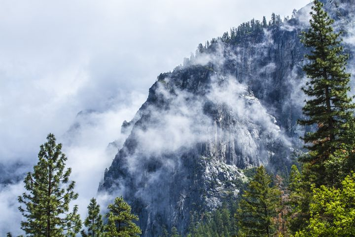 Rocky Cliff covered in clouds - Jesse Redheart