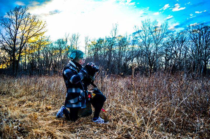 Photographer in a field. - Zelda's wonderland workshop.