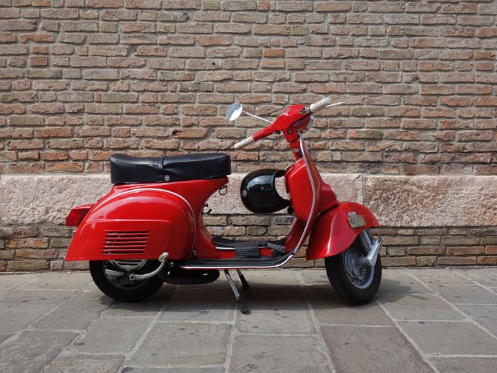 Vespa in front of the old brick wall - Abstract art