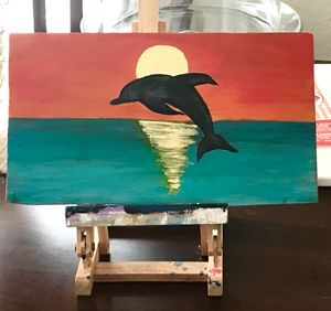 Dolphin at Sun Set - OBX Expressions