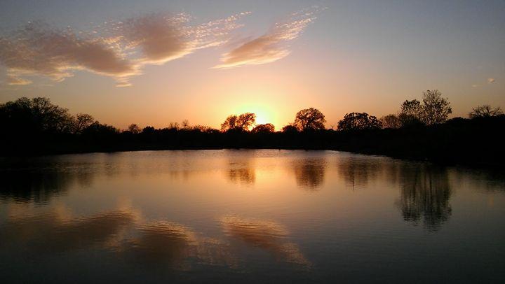 Sunset over water texas pond beauty - Brandon W. Ross