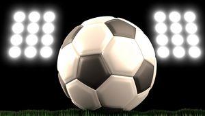 Soccer ball with stadium floodlights