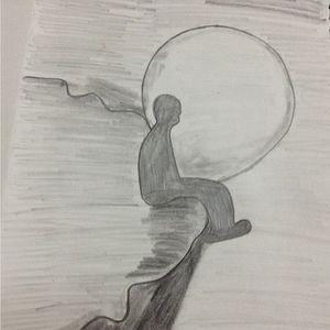 a sad boy alone sitting on mountain