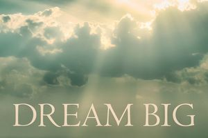 Dream Big Phrase Over Cloudscape Bac