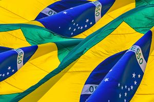 Brazilian Flag Waving Over Sky