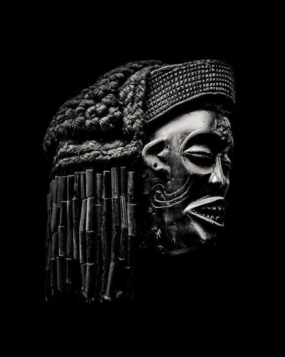 Arfican Head Sculpture on Black Back - Photography