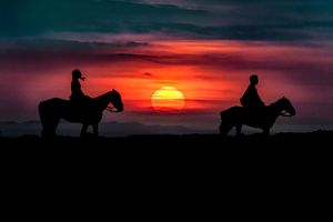 Couple Riding Horses at Nature