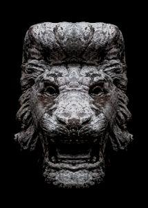 Creepy Lion Head Sculpture Over Blac
