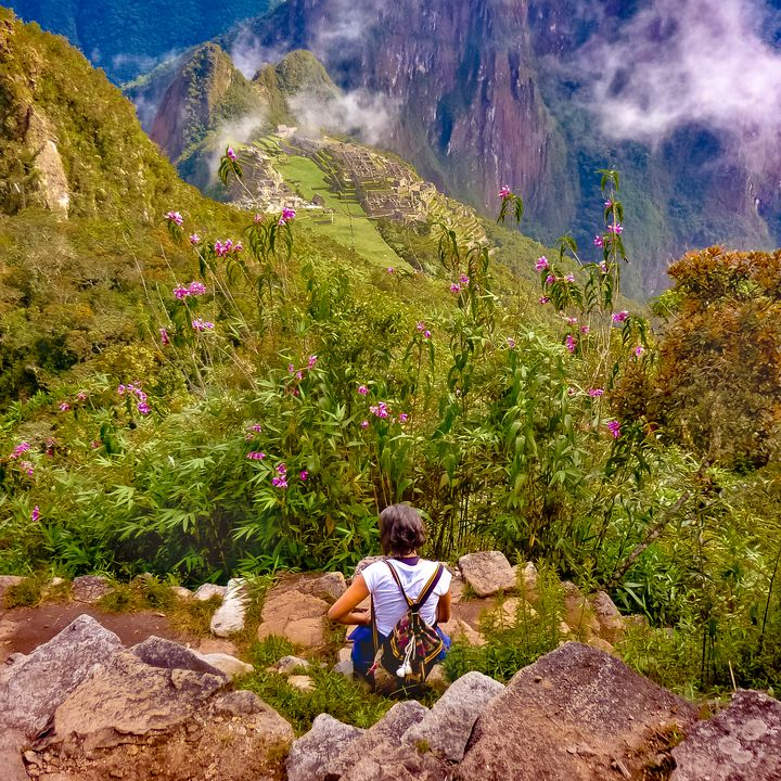 Woman Resting at Highs of Machu Picc - Photography