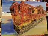 Rusty Shipwreck on Shore