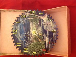 Snow scene saw blade clock