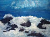 Waves break on rocks near the Monter