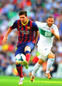 Lionel Messi controls the ball