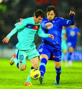 Lionel Messi vies with  Michel
