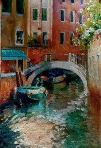 Blue boats at Venetian canal at suns