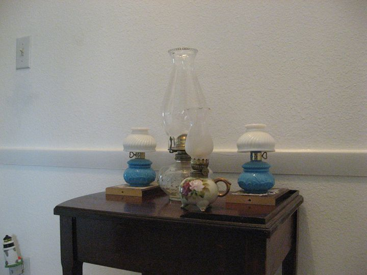 A Collection Of Oil Lamps - My Evil Twin