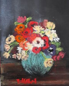 Bunch of flowers in blue green vase