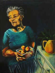 Lady holding a bowl of peaches