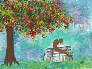 Couple under the fall tree