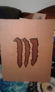 monster energy drink logo brown