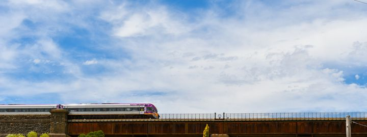 Train going over country bridge - J & A Photography
