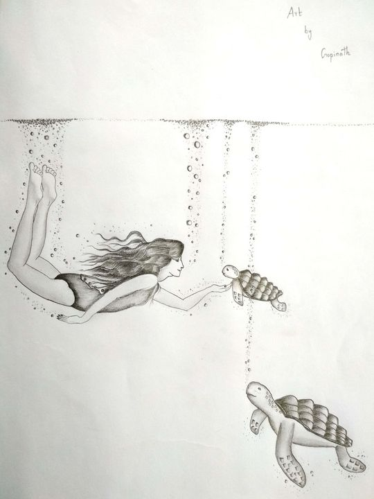 A girl swimming with turtles - Gopinath lb