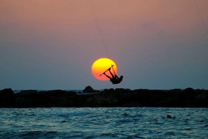 Kite surfing at sunset - PhotoStock-Israel