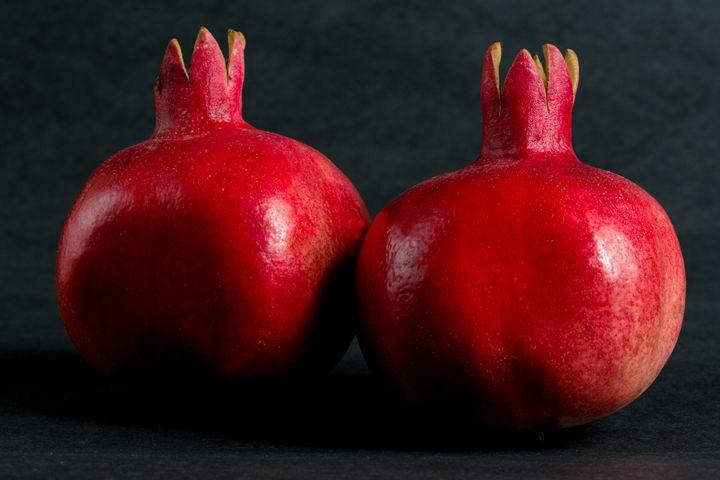 Two ripe pomegranates - PhotoStock-Israel