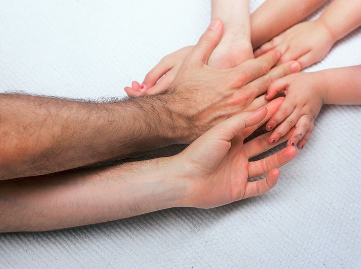 entangled Family hands - PhotoStock-Israel