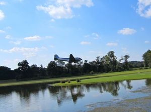 DC-3 landing on grass runway