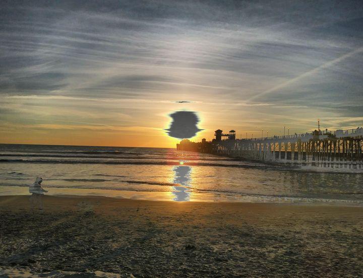 Portal at sunset Huntington beach - CMT  GRAVITY  DESIGNS