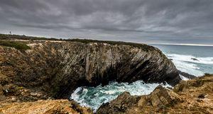 Very high cliffs on a dark day
