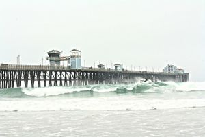 Morning Surf by the Pier