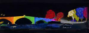 Bridge illuminating colors at night