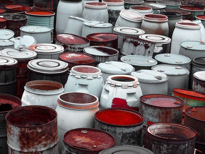 plastic  barrels of toxic waste at t - maroti