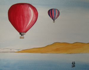 Hot air balloons over an alpine lake