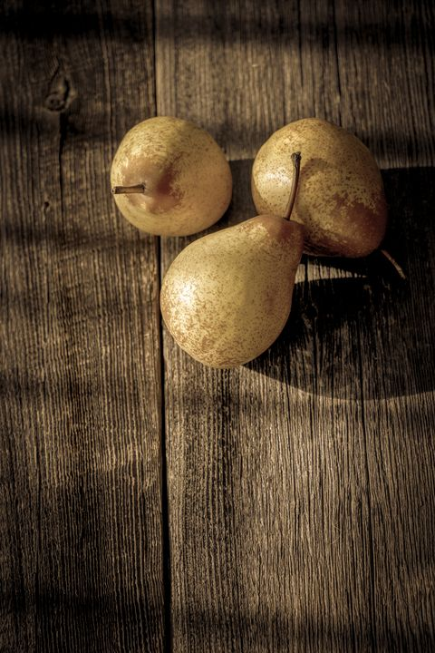 Three yellow pears on a barn wood - Francois Lariviere